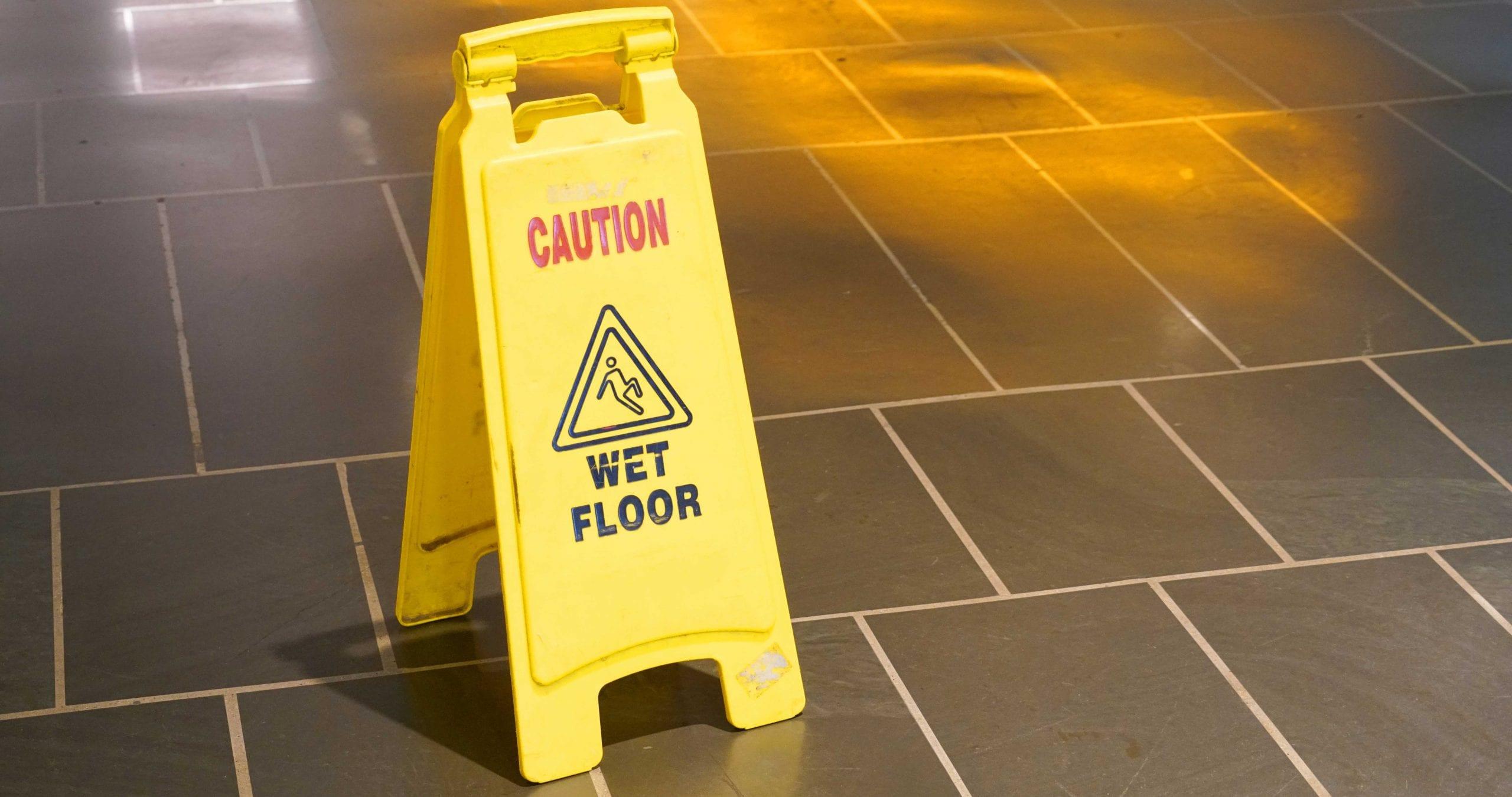 wet floor warehouse caution sign