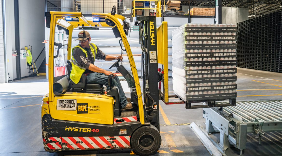 A man works in a warehouse leasing space