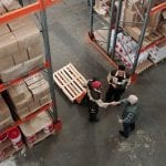 Aerial view of industrial rental property with men shaking hands
