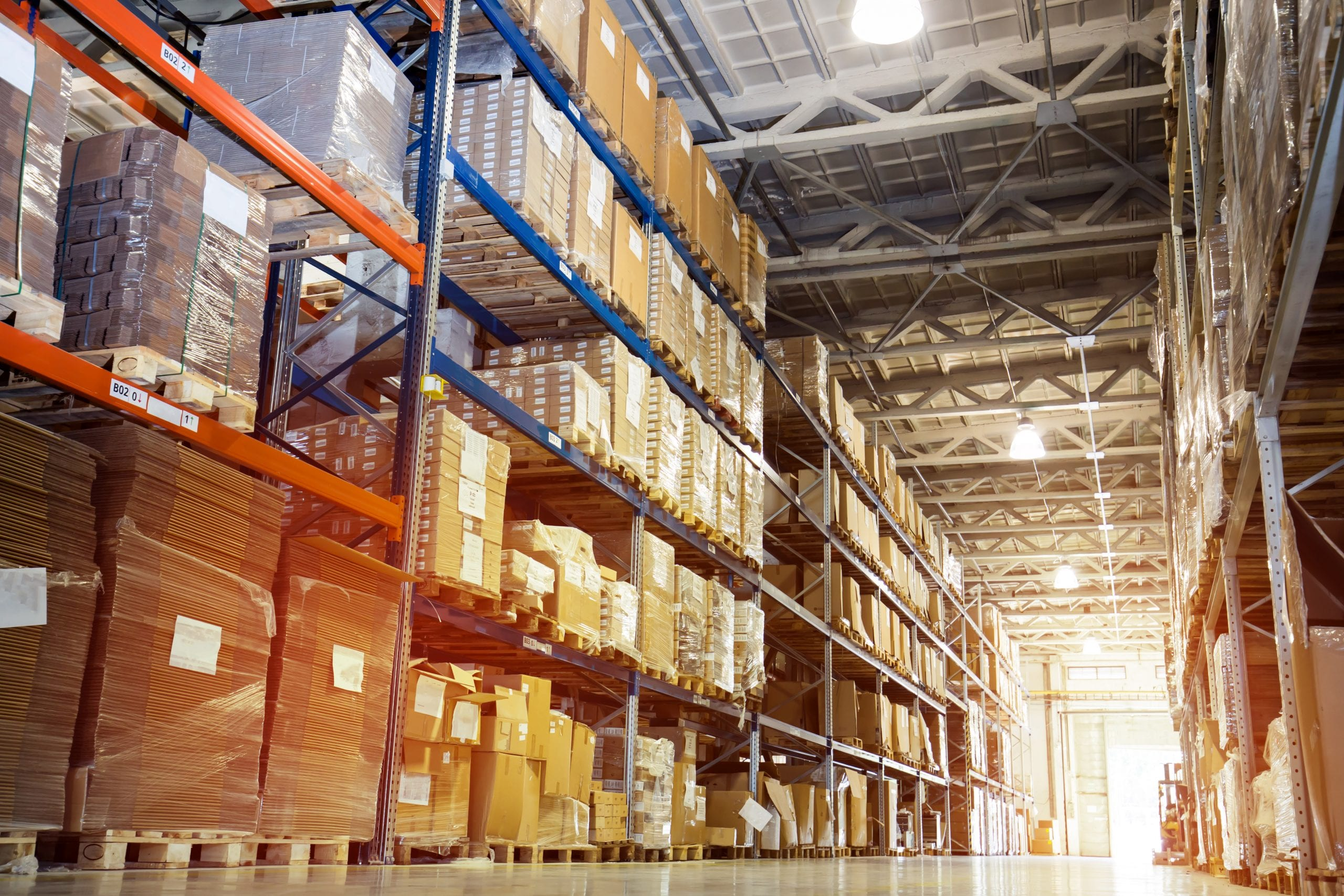 Warehouse with shelves full of storage brown boxes
